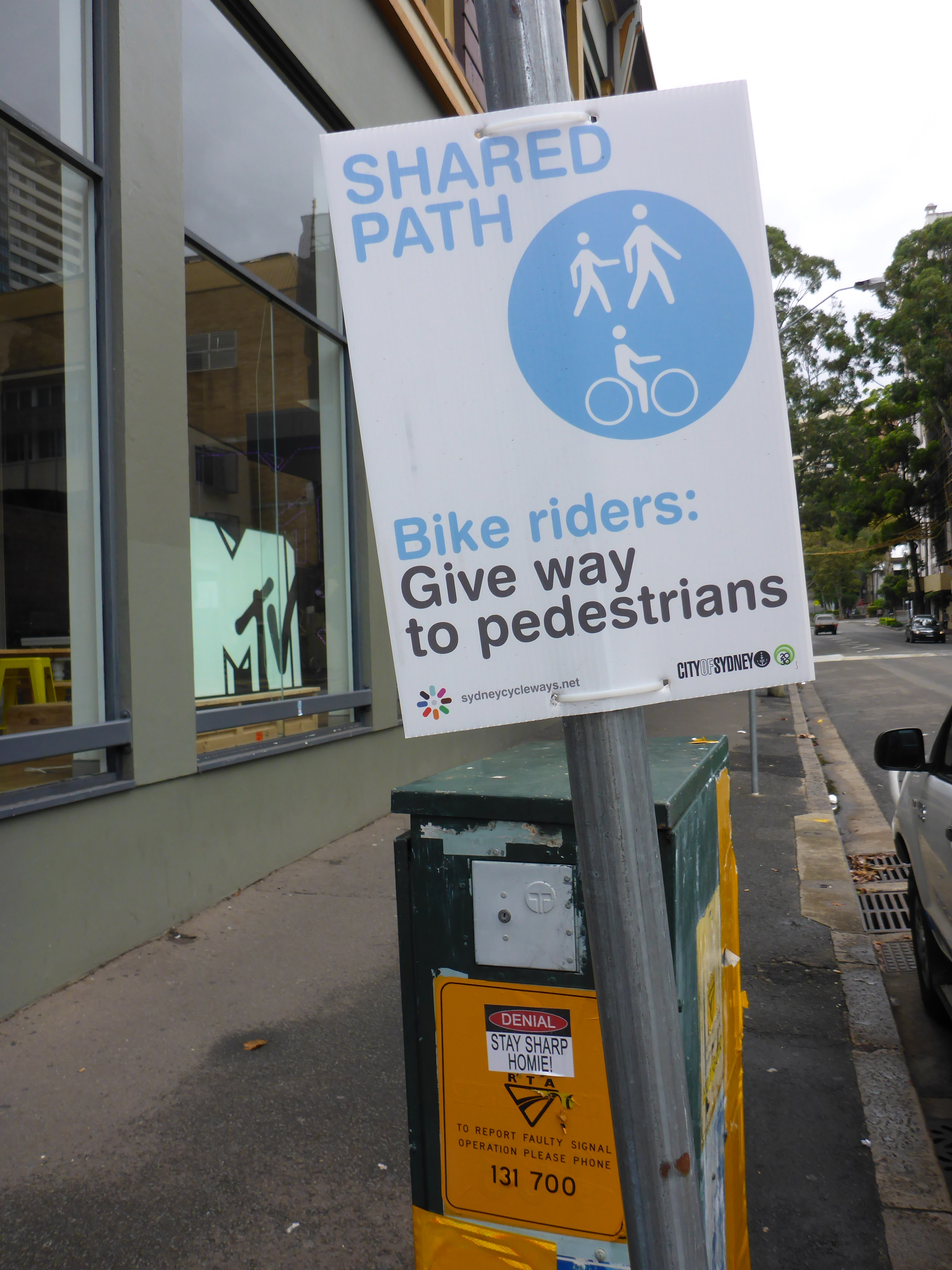 Shared space sign with pedestrian priority