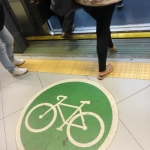 Bicycle sign in a metro allows cyclists transporting bicycle to wait at the right door